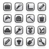 Objetos de la construcción e iconos blancos y negros de las herramientas Fotografía de archivo libre de regalías