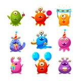 Objetos de Toy Aliens With Birthday Party Imágenes de archivo libres de regalías