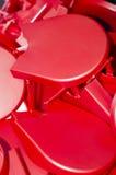 Objetos plásticos rojos Imágenes de archivo libres de regalías