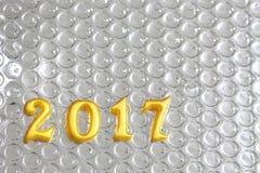 2017 objetos reales 3d en la reflexión foil, concepto de la Feliz Año Nuevo Foto de archivo libre de regalías