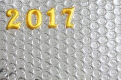 2017 objetos reales 3d en la reflexión foil, concepto de la Feliz Año Nuevo Imagen de archivo libre de regalías