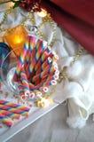 Oblea del arco iris con el fondo del concepto del partido Fotografía de archivo libre de regalías