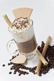 Obleas con café y habas. Foto de archivo