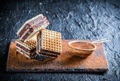 Obleas dulces con las nueces y el chocolate Imagen de archivo libre de regalías