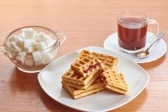 Obleas y café de la mañana Fotografía de archivo libre de regalías