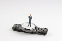 obliczenie puszka pojęcia postaci stojaka minimalny biznesowy zegarek obrazy stock