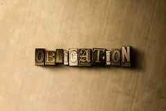 OBLIGATION - close-up of grungy vintage typeset word on metal backdrop Royalty Free Stock Image