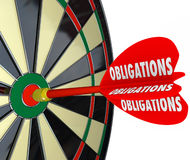 Obligations Dart Board Success in Meeting Responsibilities. Obligations word on a red dart hitting a board successfully meeting your responsibilities in life Stock Images