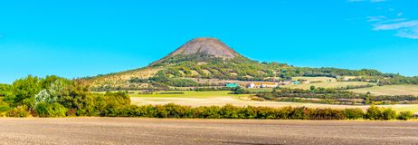 Oblik hill in the middle of Ceske Stredohori, aka Central Bohemian Highlands. Landscape with typical spiky hills of. Volcanic origin, Czech Republic stock images