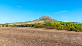 Oblik hill in the middle of Ceske Stredohori, aka Central Bohemian Highlands. Landscape with typical spiky hills of. Volcanic origin, Czech Republic royalty free stock photos