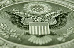 Oblique angle shot of the back of the US one dollar bill, featuring the American eagle. stock photo