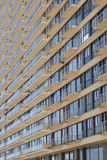 Oblique angle view of a modern apartment block. With rows of identical windows and balconies on a multi-storey high-rise building Stock Photo