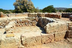 The Oblique building, Malia. Ancient walls of the Oblique building within the Minoan Malia ruins archaeological site, Malia, Crete, Greece, Europe Royalty Free Stock Images