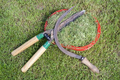Oblique lawn. And old manual tools for grass cutting background Royalty Free Stock Photo