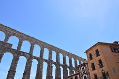 Oblique Photo Of The Aqueduct With Person Making A Photo From A Balcony Of A Nearby Bar In Segovia. Architecture, Travel, History. June 18, 2018. Segovia Royalty Free Stock Photo