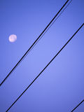 The Oblique Power Cord. Has a Blurry Moon Behind it Stock Photos