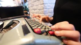 Oblique shot of hands typing on typewriter stock video