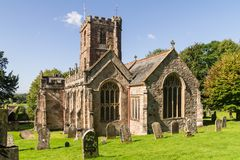 Oblique view of Crowcombe church, Somerset, in autumn sunlight. Oblique view of Church of the Holy Ghost in the village of Crowcombe , Somerset, viewed from the royalty free stock image