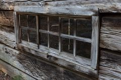 Oblique view of long log cabin window in the Great Smoky Mountains. Horizontal aspect Royalty Free Stock Photo