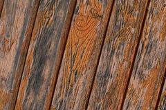 Oblique wood panel vertical strip joints weathered rigid base flaky old orange paint grunge background stock image