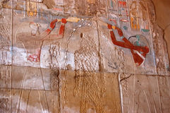 Obliterated Pharaoh. Carving on a wall at the ancient egyptian Temple of Karnak with the gods annointing the pharoah who has been chisled off the wall by a Royalty Free Stock Photography