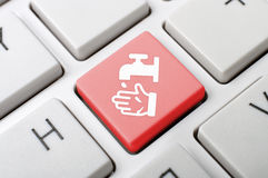 Obmycie ręki klucz na klawiaturze Zdjęcia Royalty Free