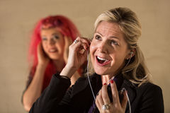 Obnoxious Woman Listening to Music Royalty Free Stock Images