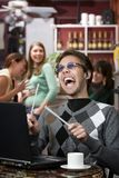 Obnoxious young man singing loudly Stock Photography