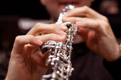 Oboe in the hands of a musician closeup Stock Photography