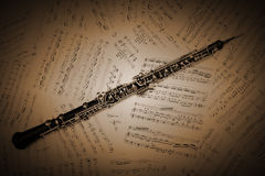 Oboe with music sheet notes woodwind instrument. Oboe with music sheet notes classical musical woodwind instruments Royalty Free Stock Images