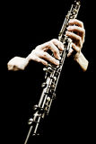 Oboe musical instrument of symphony orchestra. Oboist hands playing isolated on black. It's not clarinet, it's oboe! It is first instrument of classical Stock Photography