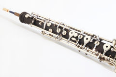 Oboe - musical instruments. Of symphony orchestra. Oboe mechanism detail closeup on white Stock Image