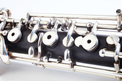 Oboe - musical instruments. Of symphony orchestra. Oboe mechanism detail closeup on white Royalty Free Stock Photos