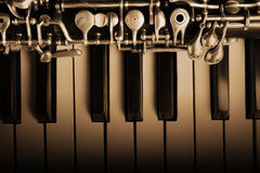 Oboe and piano musical instruments royalty free stock image