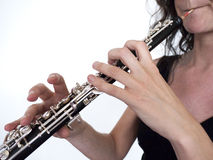 Oboe player. Hands of an oboe player on the instrument Stock Image