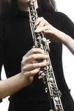 Oboe player hands playing musical instrument. Oboe player hands Woodwind musical instruments close up detail oboist royalty free stock images