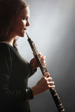 Oboe player oboist playing music instrument Royalty Free Stock Image