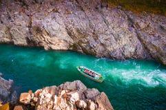 Oboke Gorge in miyoshi-shi, Tokushima, Japan. Sightseeing boat in rush water river at Oboke Gorge in miyoshi-shi, Tokushima, Japan royalty free stock photos