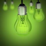 Obracająca daleko żarówka na zielonym tle Obrazy Royalty Free