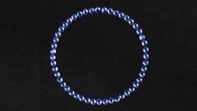 Obracanie okrąg robić błękitni rhinestones symbol nieskończoność Odgórny widok zdjęcie wideo