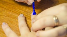 Obraz gwoździe z błękitną laką Obrazy Royalty Free