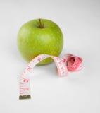 Obrazek jabłka i taśmy miara Fotografia Royalty Free