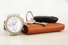 Obrazek zegarek, samochodu klucz i portfel, obraz stock
