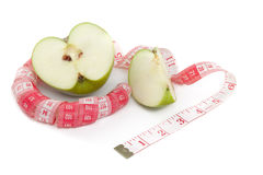 Obrazek zielona jabłka i taśmy miara Zdjęcie Royalty Free
