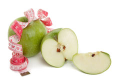 Obrazek zielona jabłka i taśmy miara Obrazy Royalty Free