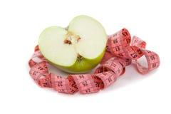 Obrazek zielona jabłka i taśmy miara Fotografia Royalty Free