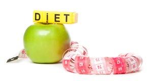 Obrazek zielony jabłko i miara taśmy Zdjęcie Stock