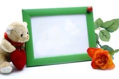 Obrazka ramy z różanego i mokietu niedźwiedziem Fotografia Royalty Free