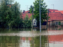 Obrenovac Serbia - May 24, 2014. Floods. OBRENOVAC, SERBIA - MAY 24, 2014: House, boat and street in Obrenovac under water. The water level of Sava River remains Stock Photos