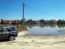 Obrenovac Serbia - May 23, 2014. Floods. OBRENOVAC, SERBIA - MAY 23, 2014: House, car and street in Obrenovac under water. The water level of Sava River remains Stock Photos